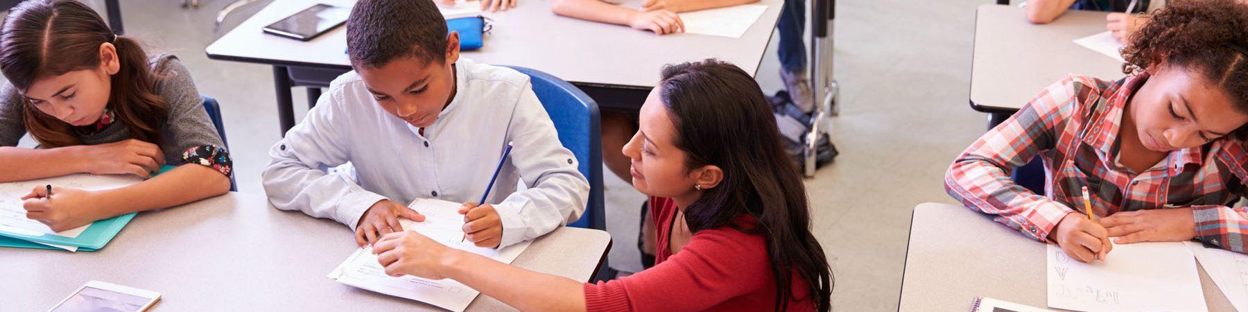 Educating Bilingual Learners Online Graduate Certificate - Bilingual education teacher helping ESL student.