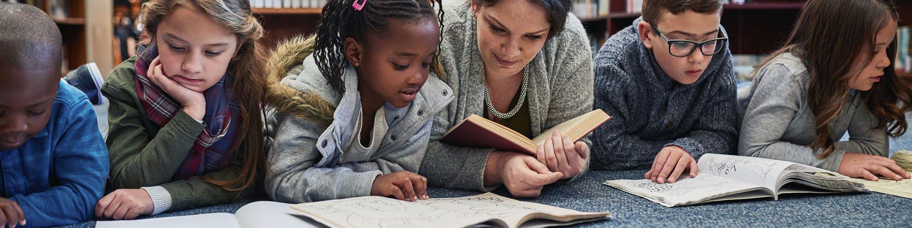 Bilingual Learners Graduate Certificate Program Online at UConn Neag School of Education - Educator teaching in a bilingual learner setting.